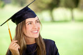 Pensive graduation student — Stock Photo
