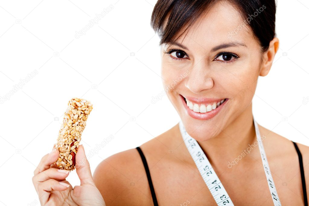 Healthy eating woman holding granola bar - isolated over a white background — Stock Photo #9066841