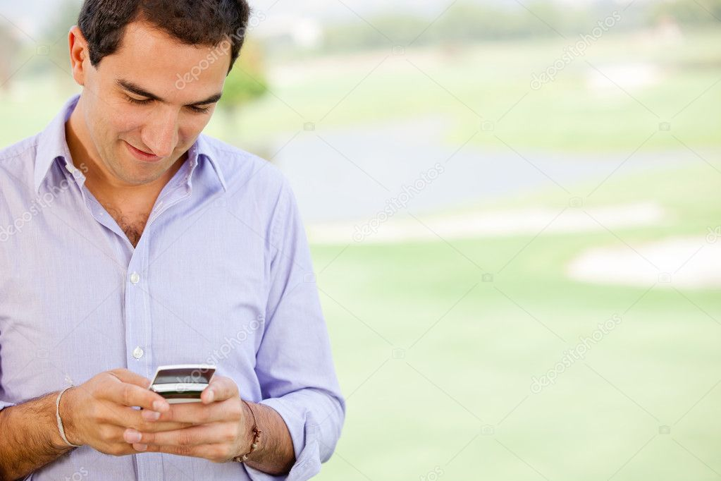 Man texting on his cell phone - outdoors — Stock Photo #9066858