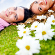Couple lying outdoors - Stock Photo