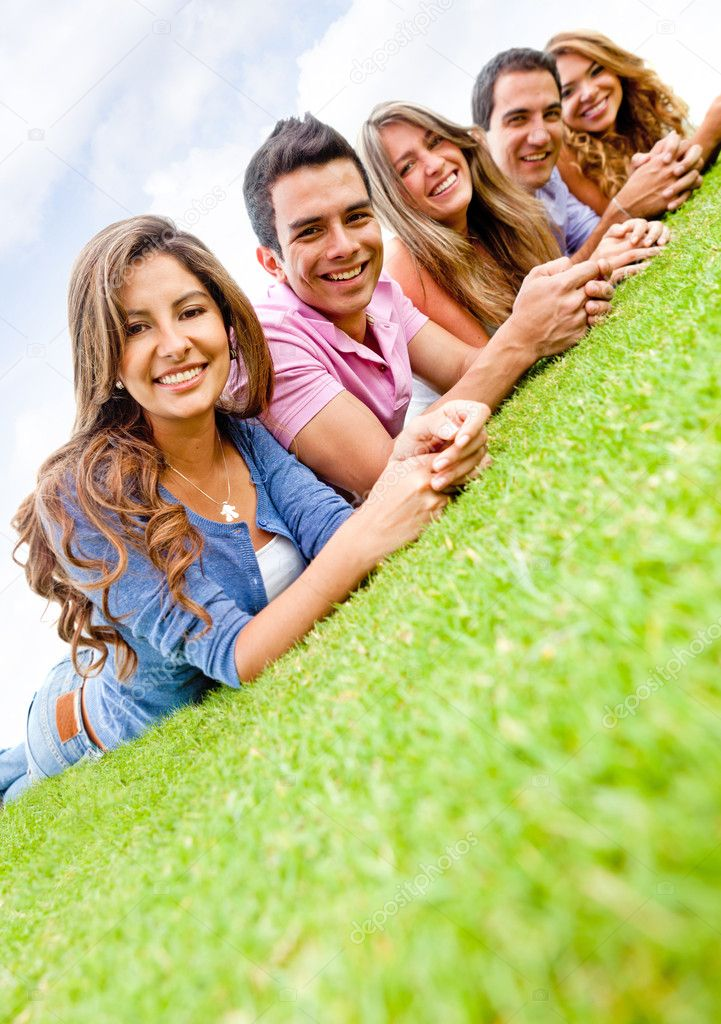 Happy group of friends lying on the floor outdoors  Stock Photo #9086295