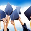 Throwing graduation hats - Foto Stock