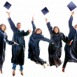 Graduation jumping - Stock Photo