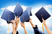 Throwing graduation hats — Stock Photo