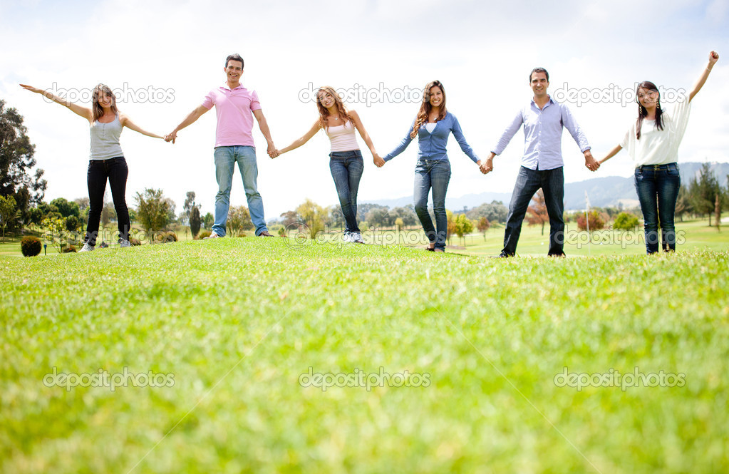 Group of friends holding hands outdoors having fun — Stock Photo #9119622