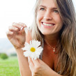 Stock Photo: Naive womwith flower