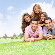 Group of friends lying outdoors — Stock Photo #9151795