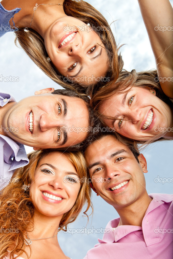 Young in a group hug and smiling — Stock Photo #9151783