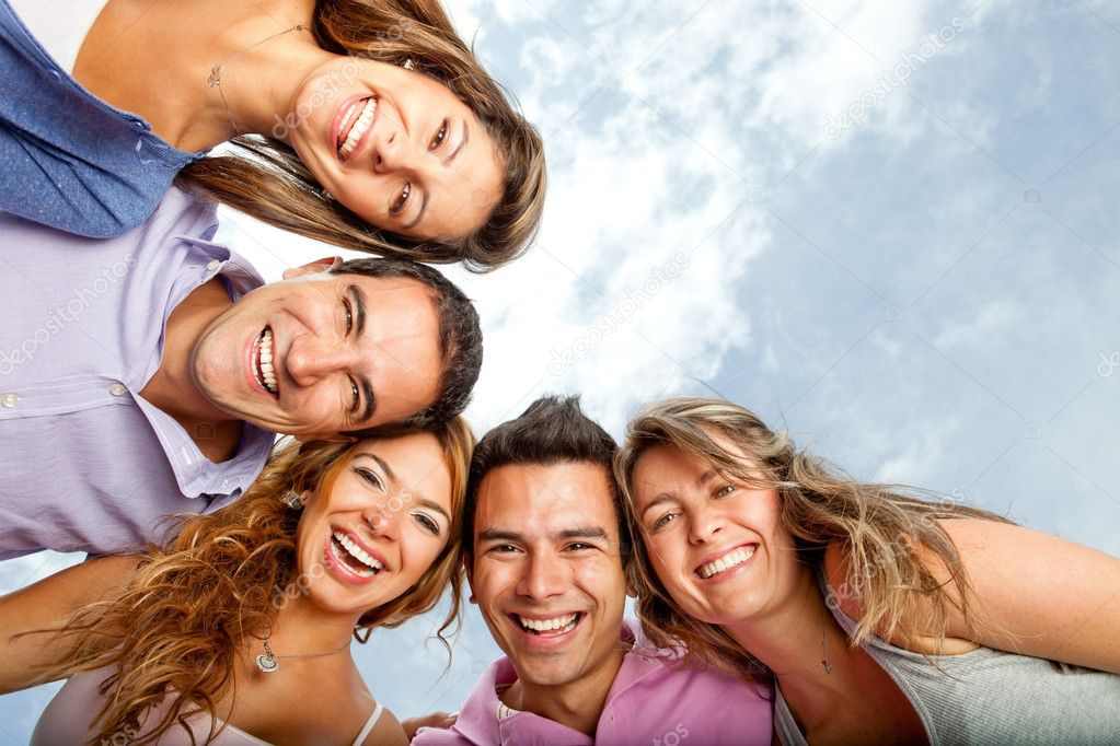 Group of young hugging and laughing  Stock Photo #9151785