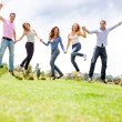 Excited friends jumping — Stock Photo
