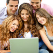 Royalty-Free Stock Photo: Friends with a laptop