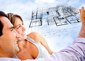 Couple with dream house — Stock Photo