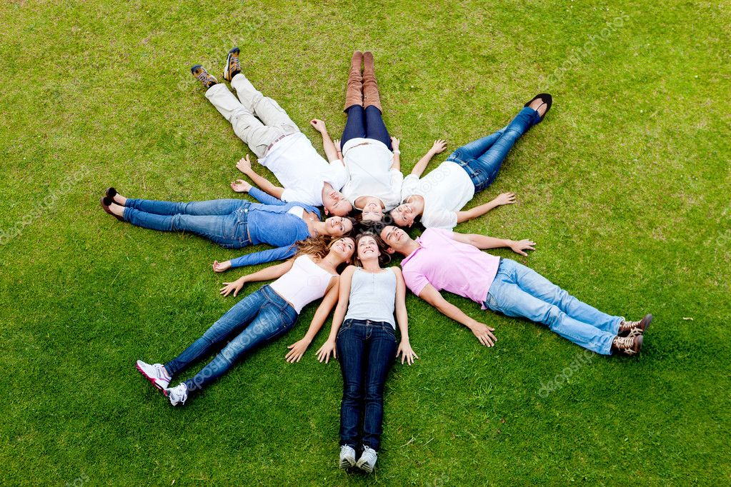 Group of young lying down outdoors  Stok fotoraf #9162609