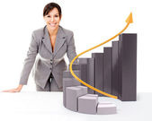 Businesswoman with growth graph — Stock Photo