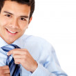 Stock Photo: Man fixing his tie