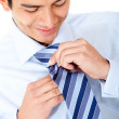 Businessman fixing his tie — Stock Photo