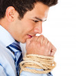 Businessman with hands tied - Stock Photo