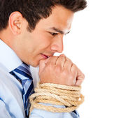 Businessman with hands tied — Stock Photo
