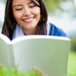 Girl reading outdoors — Stock Photo #9257546