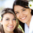 Beautiful women with flowers — Stock Photo