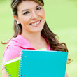 Stock Photo: Girl with notebooks