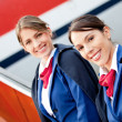 Stock Photo: Friendly air hostesses