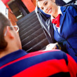 Foto Stock: Air hostesses welcoming passenger