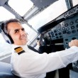 Stock Photo: Pilot in an airplane cabin