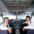 Stock Photo: Pilots in an airplane cabin