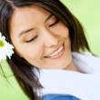 Woman with a flower in her hair — Stock Photo