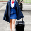 Stock Photo: Air stewardess walking