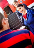 Air hostesses welcoming passenger — Stock Photo