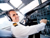 Pilot in an airplane cabin — Stock Photo