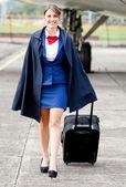 Air stewardess walking — Stock Photo