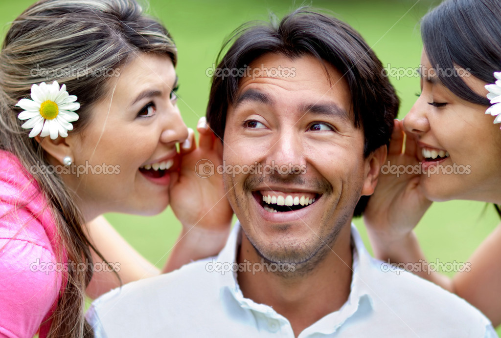 Portrait of women telling a secret to a man - outdoors — Stock Photo #9283777