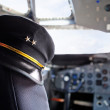 Pilot hat in an airplane - Stock Photo