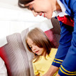 Stock Photo: Flight attendant helping kid