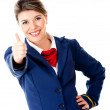 Air hostess with thumbs up — Stock Photo