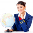 Stock Photo: Flight attendant with globe