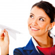 Air hostess with a paper airplane — Stock Photo #9297823