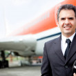 Handsome airplane pilot - Stock Photo