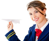 Flight attendant with a paper airplane — Stock Photo