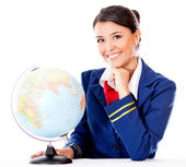 Flight attendant with the globe — Stock Photo