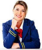 Air hostess smiling — Stock Photo