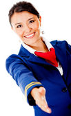 Welcoming air hostess — Stock Photo
