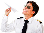 Pilot with a paper airplane — Stock Photo