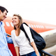 Stock Photo: Couple traveling by airplane