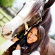 Woman with a horse — Stock Photo #9356285