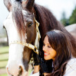 Woman with a horse smiling - Stock Photo