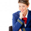 Stock Photo: Air hostess looking at table